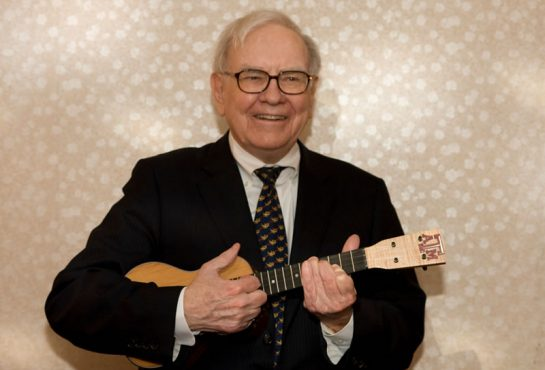 Warren Buffet playing guitar